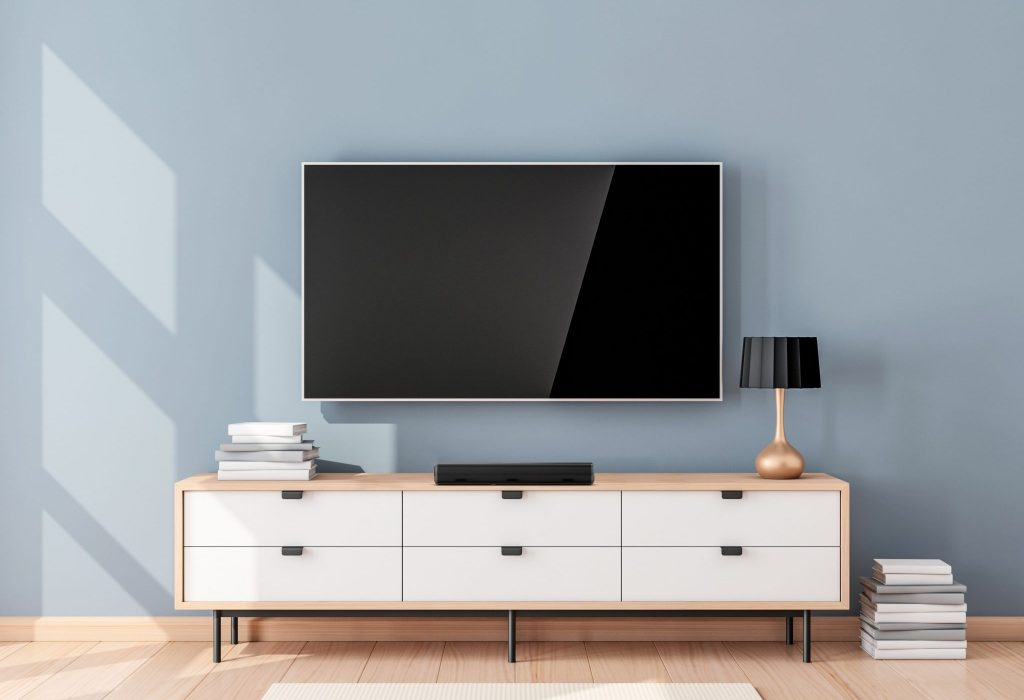 Smart Tv Mockup with blank screen hanging on the wall in modern